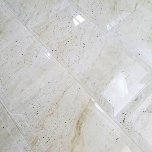 Nature X Glass Beveled Marble Look Tile In Crema Marfil X - 4 by 8 subway tile
